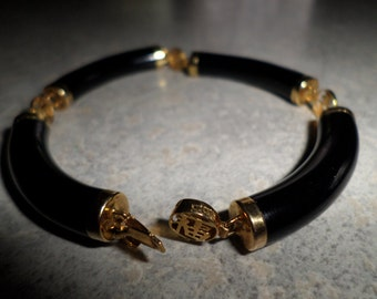 SALE!!!   Bellarri 14k gold caps and Chinese characters with tubular onyx BRACELET
