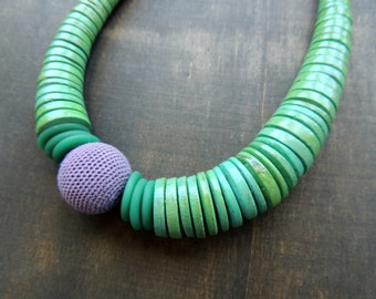 Sale 50 %: Wooden discs combined with a crochet detail in light green and light purple