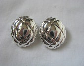 Silver tone vintage Napier clip on clip back earrings with etched design
