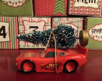 Lightning McQueen carrying Christmas tree ornament