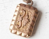 French vintage locket charm with embossed design