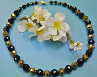 Lovely vintage 1980s faceted  black/ goldcolor glass bead necklace with flat brass beads between the beads