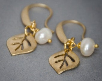 Gold earwires and leaf with freshwater pearl charm earrings