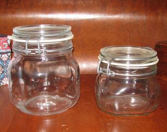 Two Italian glass storage jars