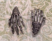 Antique Silver Skeleton Hand Charms, set of 4.