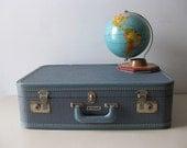 Vintage blue suitcase luggage