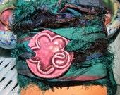 WRAP BRACELET ceramic FLOWER design in deep Purple and recycled sari silk wrap ribbon in Deep Emerald Green and Navy bluish black