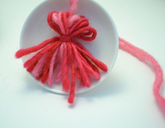 Pink Yarn Tassel; also available in black and red