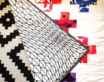 Colourful Swiss Cross Quilt made with marimekko unikko fabric
