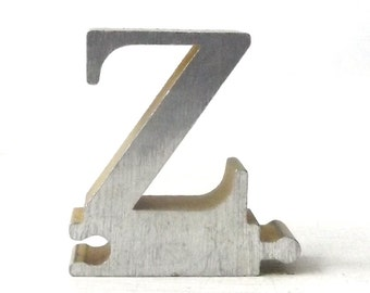 vintage 1950's letter Z puzzle piece brushed aluminum metal word home decor sign message text type font silver retro home decor small old