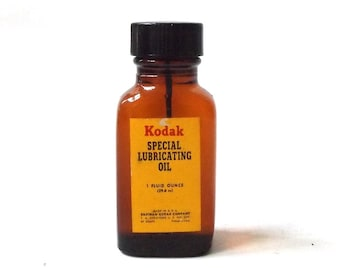 vintage 1960's kodak special lubricating oil camera photography photos 1 ounce usa mid century retro supplies tool amber glass bottle small