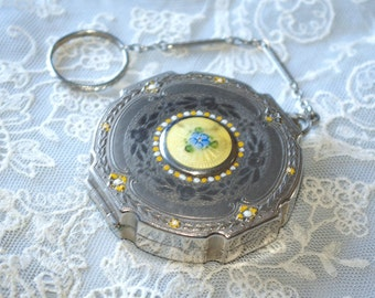 Pretty 1920s vintage compact with enamel decoration