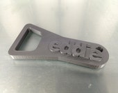 Custom 3D-printed Penny Bottle Opener. Unique personalized gift.