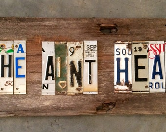 SHE AINT HEAH upcycled recycled license plate art sign tomboyART tomboy Ooak Rl Burnside