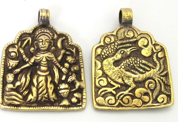 1 Pendant - Reversible ethnic forest deity brass pendant with reverse bird design from Nepal - CP074