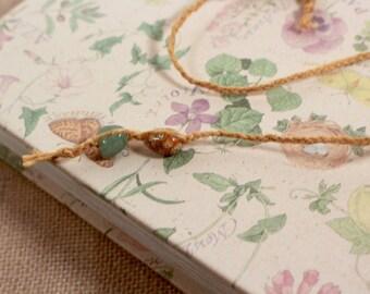Macrame hemp beaded bookmark with green and oange glass beads  braided