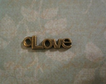 Set of 40 antique bronze love charms