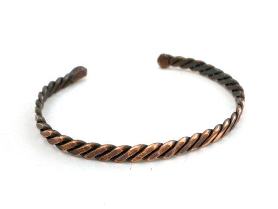 Twisted torc bracelet hand forged in earth toned by