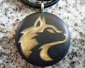 Husky design hand carved on a polymer clay black  color background. Pendant comes with a FREE necklace