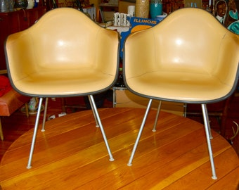 Vintage pair of padded shell chairs. Eames by Herman Miller.