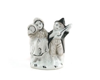 Vintage dutch boy & girl toothbrush holder, planter, pencil holder, business card holder