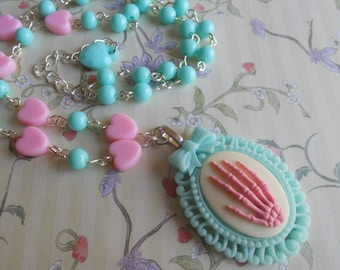 Pink skeleton hand necklace with mint and pink beads