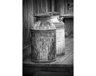 Old Creamery Milk Cans in Historical 1880 Town Western Museum in South Dakota No.3099BW A Black and White Fine Art Still Life Photograph