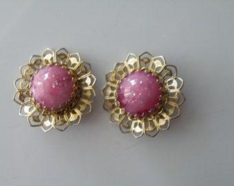 20% off Pink sparkle plastic, confetti plastic, filigree clip-on earrings.