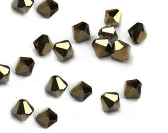 Gold Crystal Dorado 2X Swarovski bicones 4mm beads