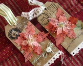 Kraft Christmas tags with sheet music poinsettias and button centers with baker's twine accent