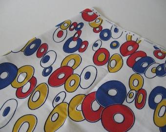 Donut ring print novelty cotton fabric Antipiega Brazil Nouveaute Bangu red yellow blue on white