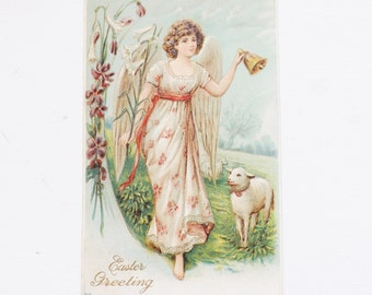 Antique Easter postcard angel ringing a bell with lamb and violets embossed