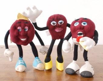 California Raisins bendable plush soft figures, vintage 1980s Hardee's advertising toys, 1988 Applause bendy posable figurines, burgundy
