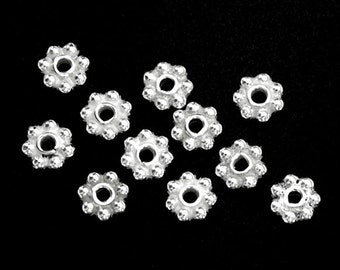 40 of 925 Sterling Silver Daisy Spacer Beads 4 mm. :th2234