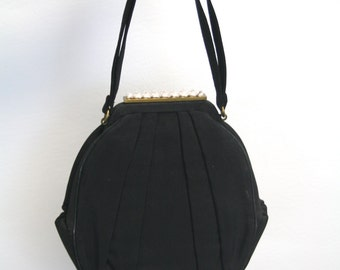 1960s Small Black Evening Bag with Pleat Details and Pink Lining
