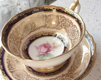 Antique English pink rose tea cup and saucer, Paragon tea cup, blue and gold tea cup, Bone China tea cup, blue tea cup, antique tea cup
