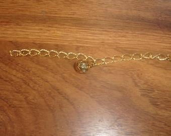 vintage bracelet goldtone chain caged jade stone