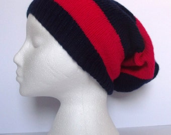 Unisex hand knitted super slouchy beanie hat. Adult or teenager. Navy blue and hot pink stripes.
