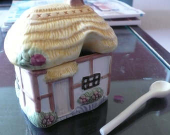 Ceramic cottage preserves pot with spoon