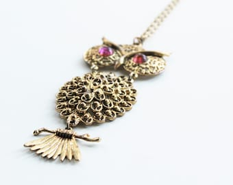 Vintage Gold Articulating Owl Pendent , Purple Glass Eyes with Long Chain
