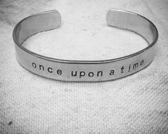 once upon a time : hand stamped aluminum cuff fangirl  bracelet