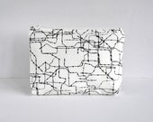 Padded woman's make up bag cosmetics pouch Modern subway route circuit lines print in black and white in large.