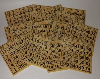 Vintage game 1970s paper Bingo game cards yellow lot number sheets altered art scrap project supplies