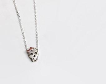 Tiny skull with bow necklace silver handmade.