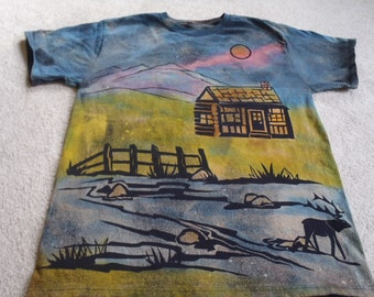 Log cabin with a stream, mountains and elk, man's large discharge t-shirt with procion dyes, brilliant blue, pink, chartreuse, baby blue