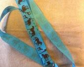 Brown horses on turquoise ribbon lanyard