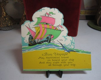 Colorful unused art deco die cut 1920's-30's Bon Voyage greeting card pink, green, yellow sailing ship seagull cloud bursts