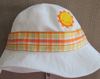Toddler sun hat with orange plaid ribbon and sun