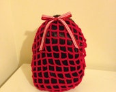 Red crochet snood with gingham bow
