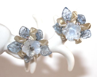periwinkle blue glass floral clip earrings. Made in W Germany